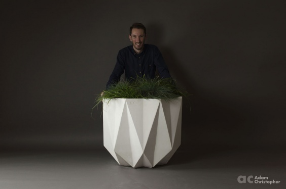 Adam Christopher behind his concrete planter Prisme