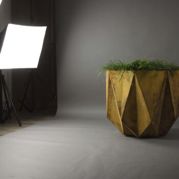 studio setting of modern designer planter in rusty concrete