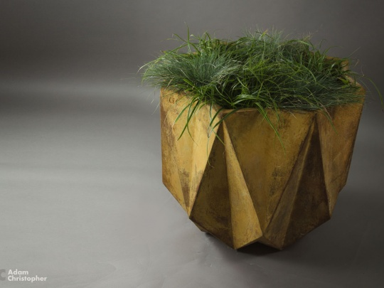 large orange planter with grasses