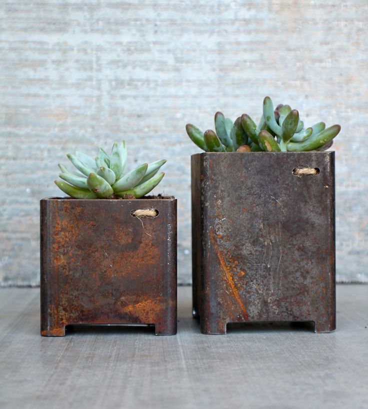 rusty flower pots with little legs
