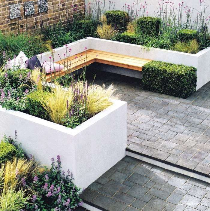 corner seating area with built in planters