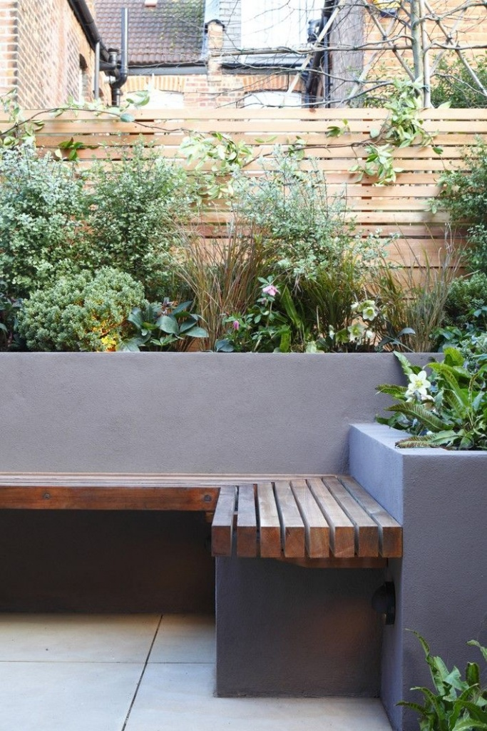 dark grey concrete with bench and built in planters