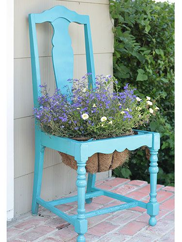 blue wooden chair as a flower pot with legs