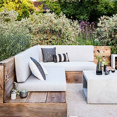 rustic wooden seating and planting area