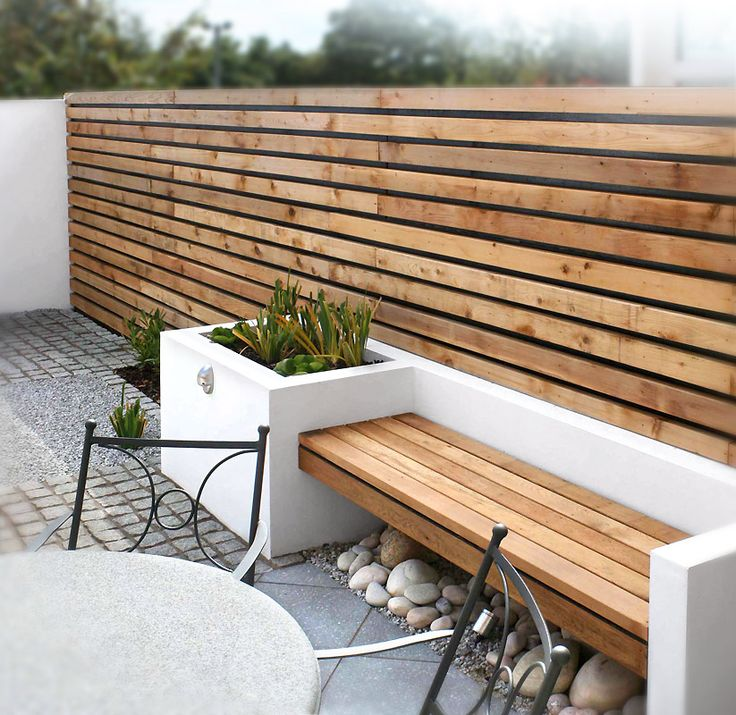 white concrete planter bench