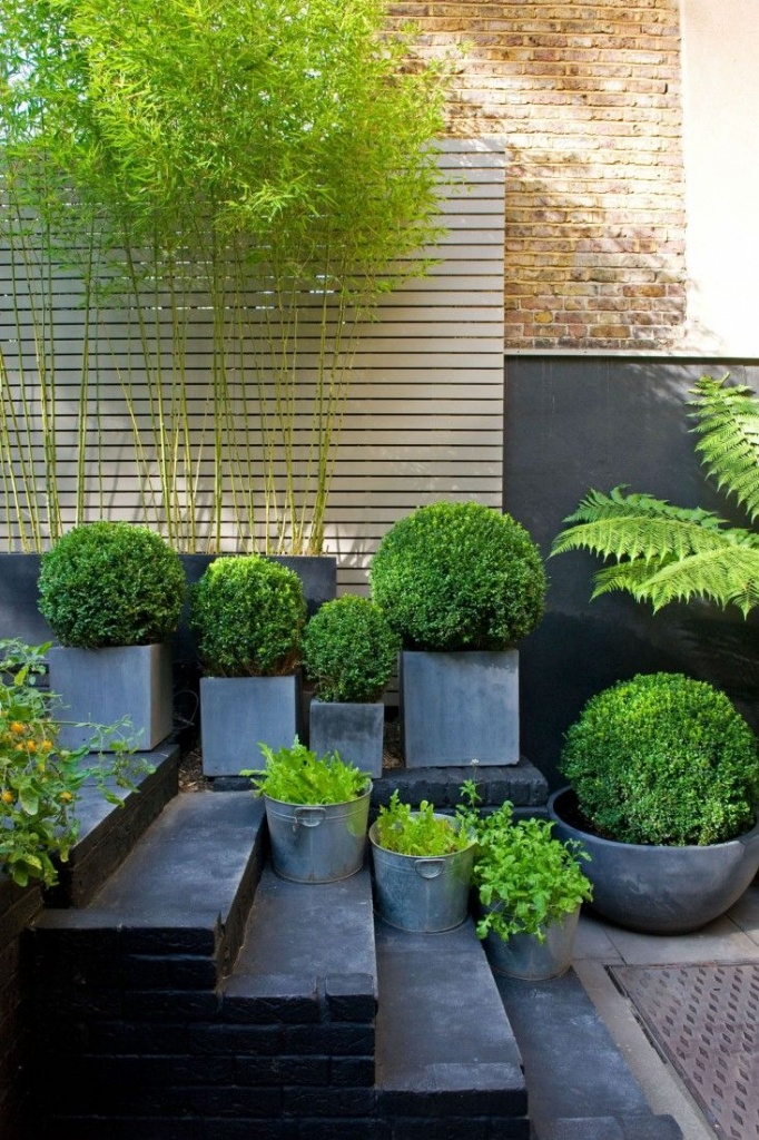 muted grey planters on steps