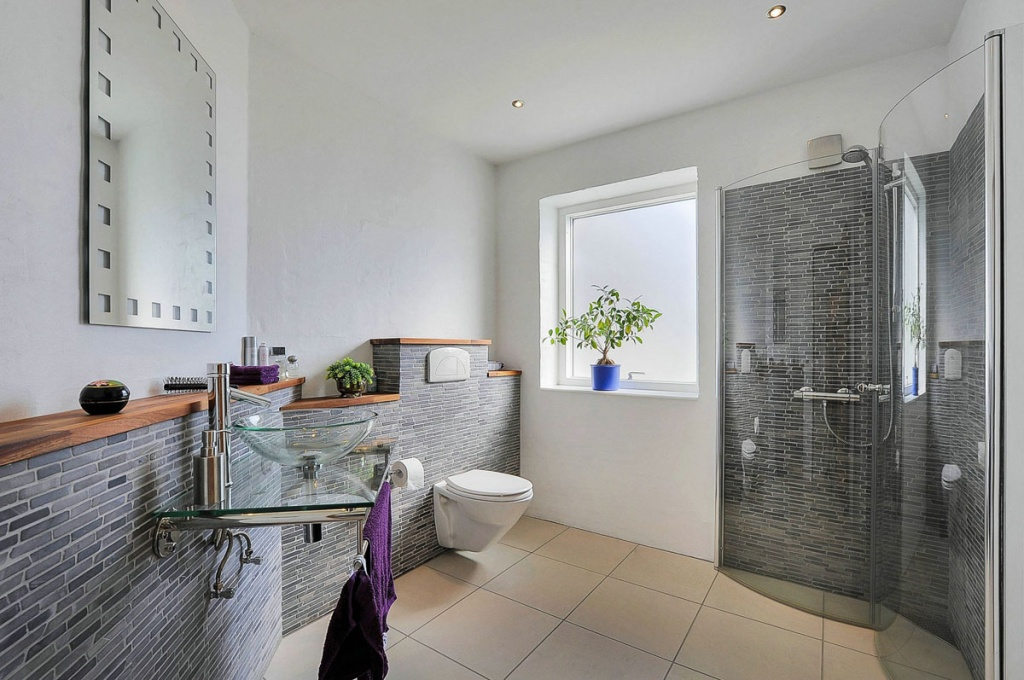 bathroom with stylish tiling