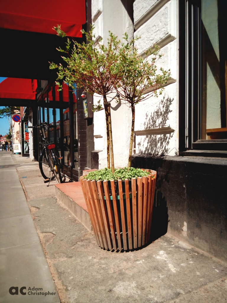 wooden taper planter on the street