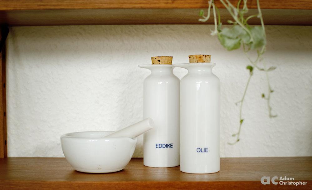 ceramic pestal and mortar on a shelf logo 1000