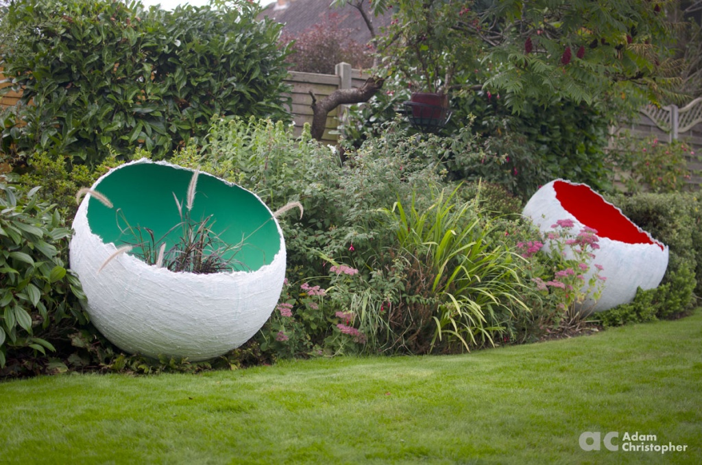green-egg-sculpture-planter-with-grass-planting-logo