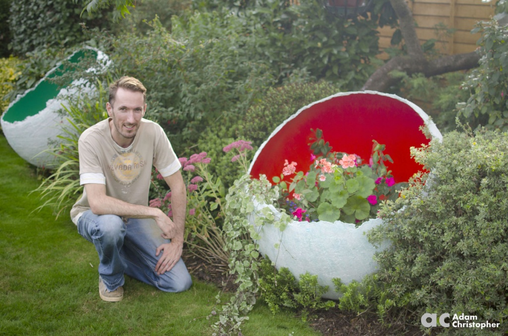 adam-christopher-with-egg-sculpture-logo