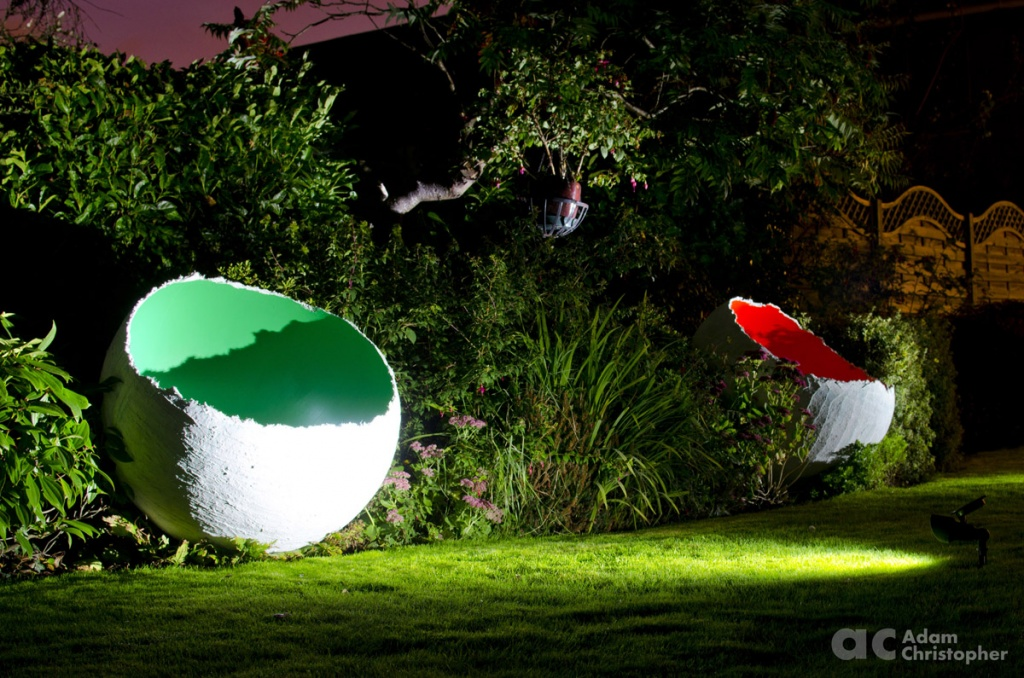 red-and-green-1-m-egg-sculpture-by-ac-design-logo