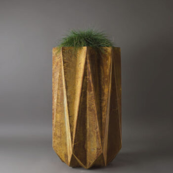 geometric fibre flower pot in rusted effect concrete