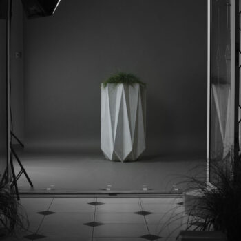 mood shot of tall elegant concrete planter