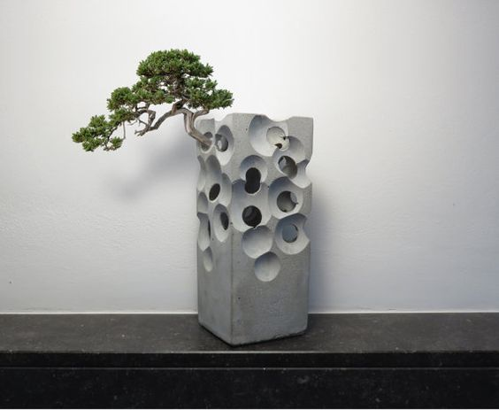interesting concrete planter. But that s OK because these don t need to support great weights  just look cool Swiss cheese concrete planter 10 Concrete Planters for Creative Crackerjacks Award Winning