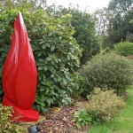 flame contempary garden sculpture in red