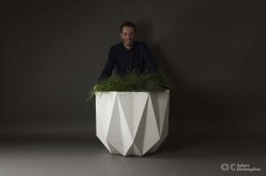 Adam Christopher behind his concrete planter Prisme