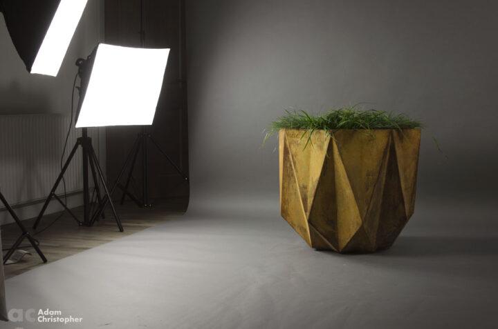 studio setting of modern designer planter in rusty concrete
