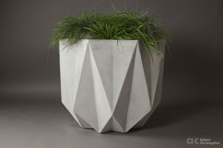 Large concrete planter in a geometric form with faceted edges. modern design for architects and designers