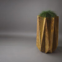 faceted planter in rust effect standing 90 cm tall