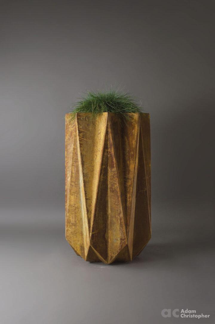 geometric fibre flower pot in rusted effect concrete